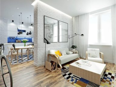 Кирпичная стена в небольшой квартире студии