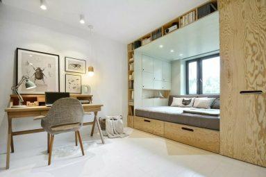 Кровать на подиуме и интерьере квартиры